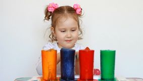 Child and science experiment. Entertainment for children. preschool education. Multicolored drinks. A cute little girl. Entertainment for children. Child and stock video footage