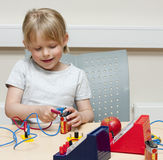 Child scientist. Cute little girl (5 years old) doing experiments with electricity Stock Photography
