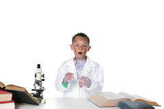 Child scientist blowing up tubes Royalty Free Stock Photos