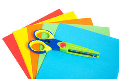 A child scissor with folding colored leave Royalty Free Stock Photos