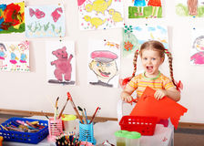 Child with scissors  in play room. Stock Images
