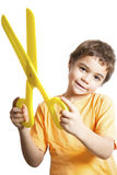 Child with scissors. Smiling and happy boy with scissors Royalty Free Stock Photo