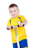 Child with scooter Royalty Free Stock Photography