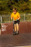 Child with scooter at the skate parc Stock Photo