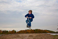 Child with scooter at the skate parc Royalty Free Stock Photo