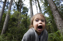 Child Screaming for  Help. Adorable little girl is screaming for help in the woods Royalty Free Stock Photo
