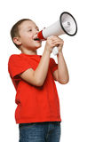 Child screaming into a megaphone. Excited child screaming into a megaphone over whie background Royalty Free Stock Images