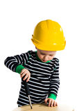 Child with screwdriver. Little baby boy playing with screwdriver - isolated on white background Stock Image