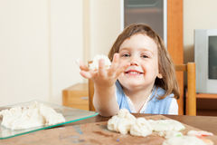 Child sculpting from clay at table. In home royalty free stock photography