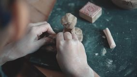 Child sculpts the clay craft. the little girl is engaged in pottery.  stock footage
