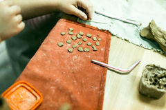 Child sculpts the product from raw clay Royalty Free Stock Photo