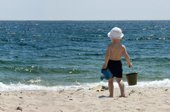 Child At The Sea. Summer vacations. sunny weather Royalty Free Stock Image