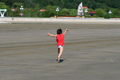 Child by the sea. The image of the Angell by the sea Stock Image
