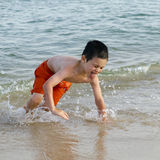 Child in sea on beach Stock Photography