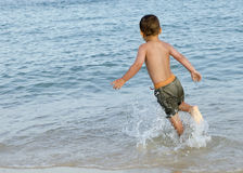 Child in sea on beach Royalty Free Stock Photos