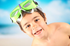 Child by the sea. Happy boy by the sea with diving mask Royalty Free Stock Image