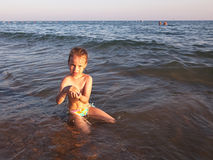 Child in sea water. Stock Images