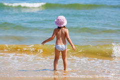 Child and sea waves Royalty Free Stock Photo