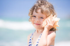 Child with seashell Stock Photography