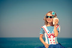Child with seashell on summer vacation Royalty Free Stock Images