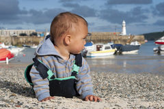 Child at seaside Stock Image