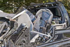 Child seat in car wreck. Closeup of infant safety seat in twisted metal car wreck outdoors Royalty Free Stock Photos