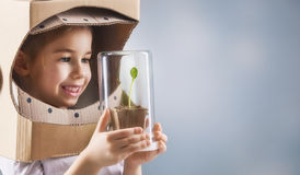 Child sees a sprout Royalty Free Stock Photos