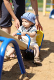 Child on seesaw Royalty Free Stock Photos