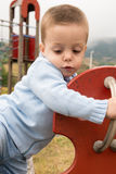 Child in a seesaw Stock Photo