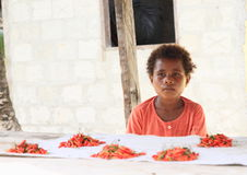 Child seller of chilli paprikas Royalty Free Stock Photos