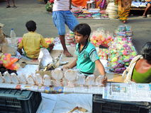 A child selling idols in the street Royalty Free Stock Photography
