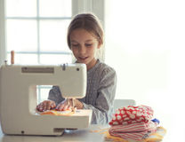 Child sewing