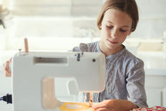 Child sewing Stock Images
