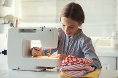 Child sewing Royalty Free Stock Photos