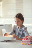 Child sewing Stock Photo