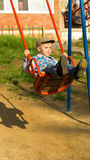 The child shakes on a swing Royalty Free Stock Photo