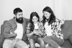 Child share news with mother and father. Little girl child use mobile phone. Happy family at home. Buy online. Child royalty free stock image