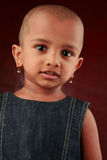 Child with shaved head Royalty Free Stock Image