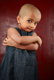Child with shaved head. Portrait of a girl child with shaved head Stock Photography