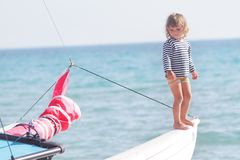 Child on ship on sea background Royalty Free Stock Photography