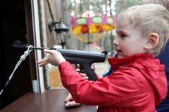 Child shooting air pistol Royalty Free Stock Image