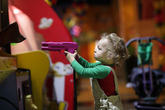 Child shooting a pistol Royalty Free Stock Images