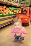 Child in a shop Stock Images