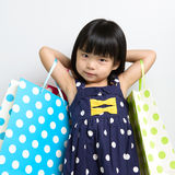 Child with shopping bags Stock Image