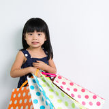 Child with shopping bags Royalty Free Stock Photos