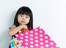 Child with shopping bags Royalty Free Stock Photography