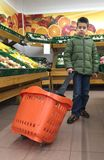 Child with a shopping car in a supermarket Stock Photography