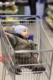 Child in shopping cart Stock Photo