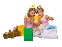 Child shopping delight. Children consider gifts with delight over white background royalty free stock photography