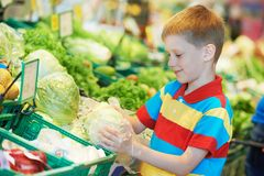 Child shopping at supermarket Royalty Free Stock Image